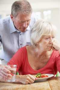 Senior man looking after sick wife